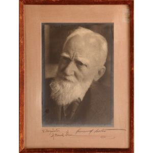 Attractive inscribed photographic portrait on textured paper by Howard Coster.