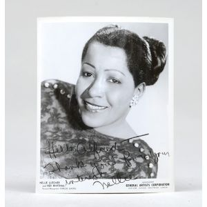 Signed 10 x 8 glossy publicity photograph.
