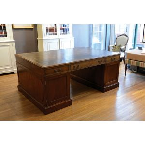 George III-style mahogany twin pedestal partners desk.