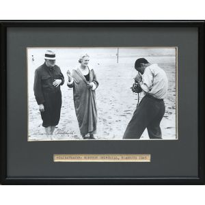 Signed original photograph of Churchill with his wife on the beach at Hendaye, July 1945.