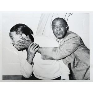 """""""Duke Ellington and Louis Armstrong ham it up backstage at Madison Square Garden in New York City during tribute to the Duke""""."""